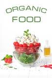 Green salad, cherry tomatoes, mini mozzarella. Organic food on a white background royalty free stock photo