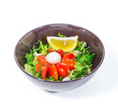 Green salad with cherry tomatoes and mozzarella. Over white background Stock Image