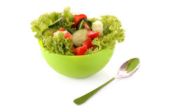 Green salad, cucumber and tomato in green plate Stock Image