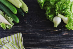 Green salad, cucumbers, zucchini, squash, and onion Stock Photo