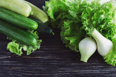 Green salad, cucumbers, zucchini, squash, and onion Stock Images