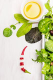 Green salad with dressing on white wooden royalty free stock image