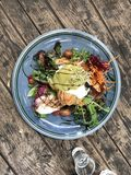 Green salad with egg Benedict. Healthy breakfast Royalty Free Stock Photography