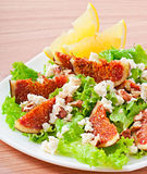 Green salad with figs, cheese and walnuts Stock Image