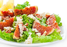 Green salad with figs, cheese and walnuts Royalty Free Stock Images