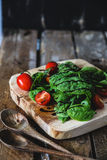 Green salad. Fresh green salad with basil and tomato Stock Photos