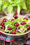 Green salad with fresh cherries Stock Photo