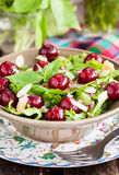 Green salad with fresh cherries Stock Photography