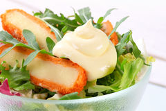 Green salad with fried cheese. And salad dressing royalty free stock photos