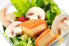 Green salad with fried cheese Stock Photo