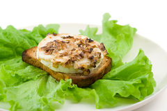 Green salad with goat cheese and toast Stock Photo