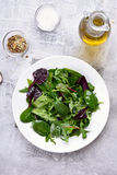 Green salad with leaves of spinach, arugul Stock Photo