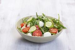 Green salad made with arugula, tomatoes, mozzarella Stock Photos