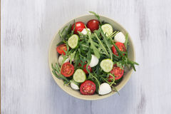Green salad made with arugula, tomatoes, mozzarella Stock Photos