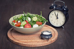 Green salad made with arugula, tomatoes, mozzarella Stock Image