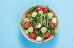 Green salad made with arugula, tomatoes, mozzarella Stock Photography