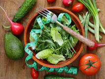 Green salad with measuring tape - diet Stock Images