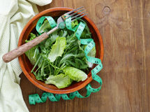 Green salad with measuring tape - diet Royalty Free Stock Images