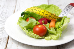 Green salad with measuring tape stock photography