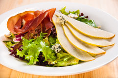 Green salad mix with pears and jamon Stock Images