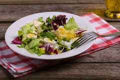 Green salad mix, still life on rustic wooden background Stock Photo