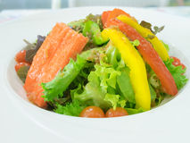 Green salad with olives, tomatoes and crab. Bowl of  green salad with olives, tomatoes and crab Stock Photos