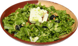 Green salad with piece of cheese and olives Stock Photo