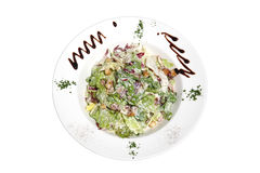 Green salad on plate. Caesar salad on decorated plate Stock Photo