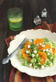 Green salad with pumpkin, feta and almonds. Served on a plate Royalty Free Stock Image