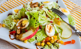 Green salad with quail eggs, corn and sweet apple Royalty Free Stock Images
