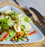 Green salad with quail eggs, corn and sweet apple Royalty Free Stock Photos