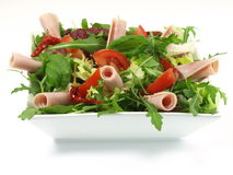 Green salad with rocket and tomato as a appetizer Stock Photography