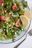Green salad with salmon, cucumber, cream cheese and caviar Royalty Free Stock Image