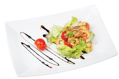 Green salad with shrimp and tomatoes on a platter Royalty Free Stock Images