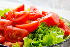 Green salad and sliced tomatoes Stock Photo