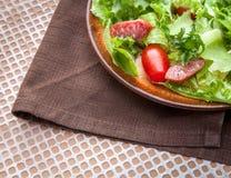 Green salad with smoked sausage Stock Photo