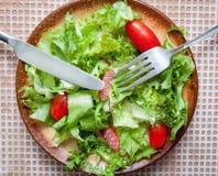 Green salad with smoked sausage Royalty Free Stock Photos
