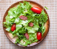 Green salad with smoked sausage Stock Photos