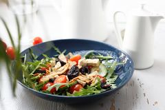 Green salad with tofu, cherry tomatoes, arugula, cucumber royalty free stock photography
