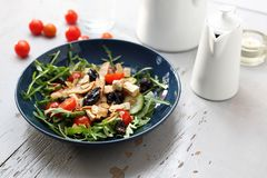 Green salad with tofu, cherry tomatoes, arugula, cucumber stock photo