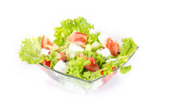Green salad with tomato and cheese Stock Photo
