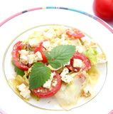 Green salad with tomatoes and cheese Stock Images