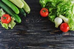 Green salad, tomatoes, cucumbers, zucchini, squash, and onion Stock Image