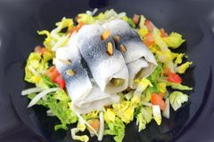 Green salad with tomatoes and fish Stock Image