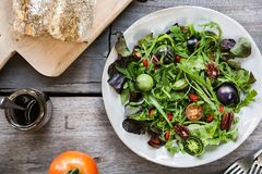 Green Salad with Green Tomatoes,Pecan and Goji berry Stock Photography