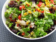 Green salad with tomatoes and peppers Royalty Free Stock Photos