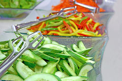 The green salads. The close-up of tasty natural vegetarian salads Stock Photo
