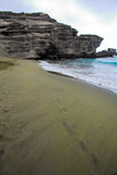Green sand beach. Rocky cliffs and beach with green sand on Big Island Royalty Free Stock Images