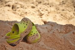 Green sandals on a beach Stock Image
