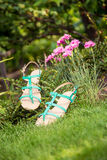 Green sandals lie on the grass, ladies comfortable shoes Stock Photos